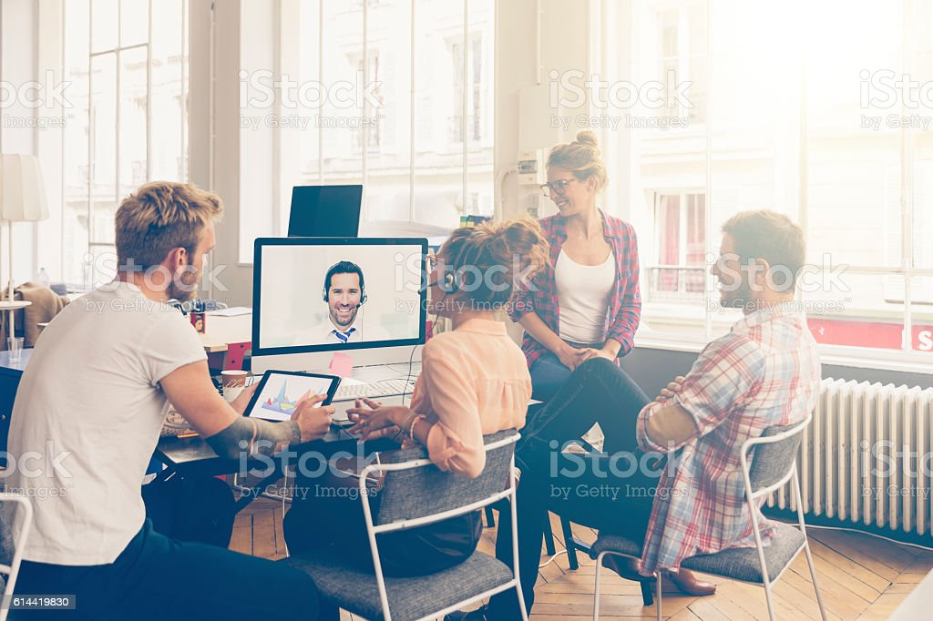 Coworkers doing a video conference in the conference room stock photo