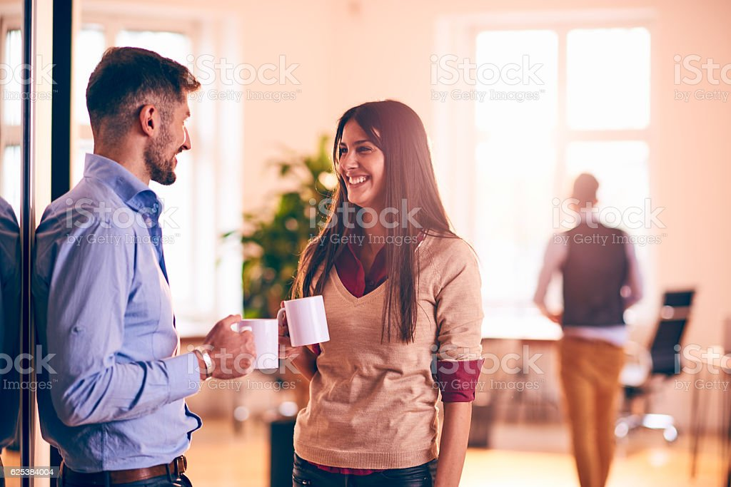 Coworkers drinking coffee stock photo