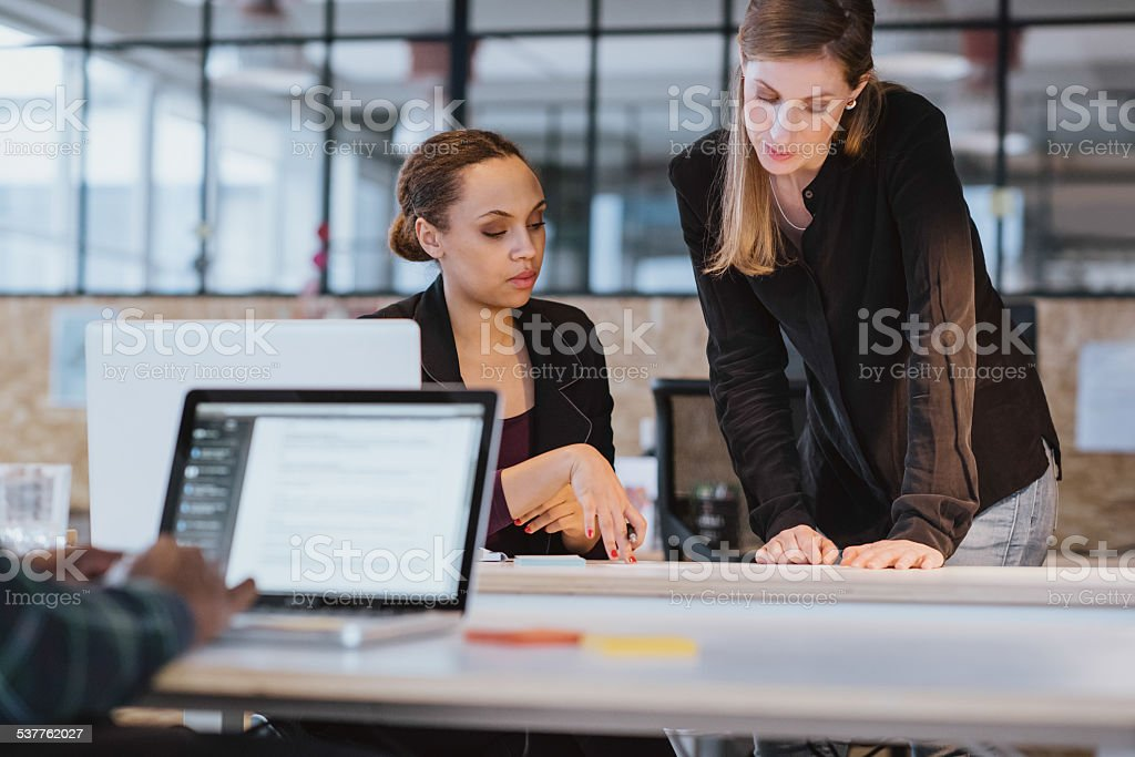 Coworkers going through paperwork together royalty-free stock photo