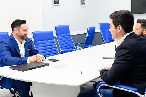 Professional office workers in a modern conference room