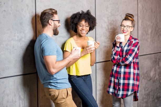 Coworkers having a coffee break stock photo