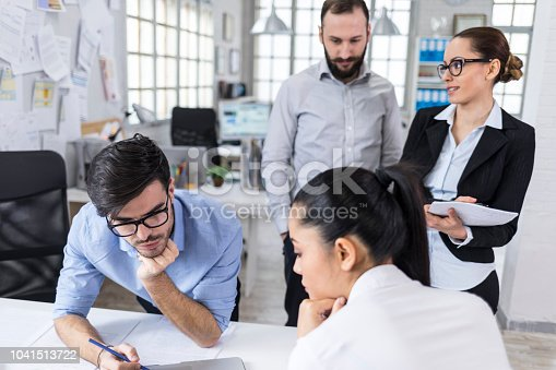 istock Coworkers in modern office 1041513722