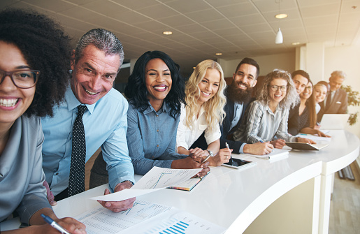 690855708 istock photo Coworkers in office smiling and looking at camera 1019437860