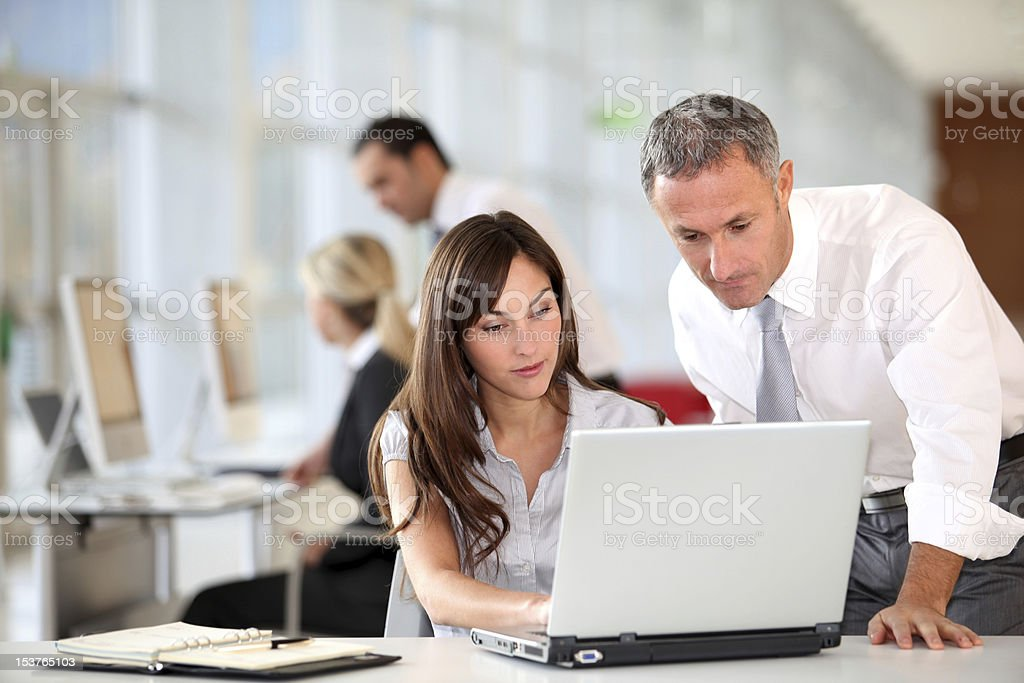 Co-workers in the office stock photo