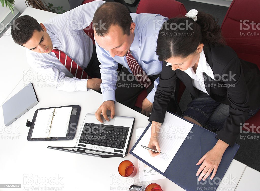 Coworkers in the office working together royalty-free stock photo