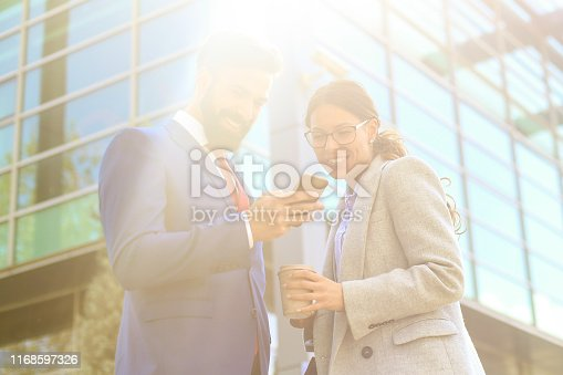Business people on the street. Both about 25 years old, Caucasian people.