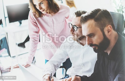 533699494 istock photo Coworkers photo in sunny office.Managers team work new idea 528605814