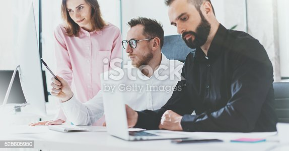 533699494 istock photo Coworkers photo in sunny office.Project managers team work new 528605950