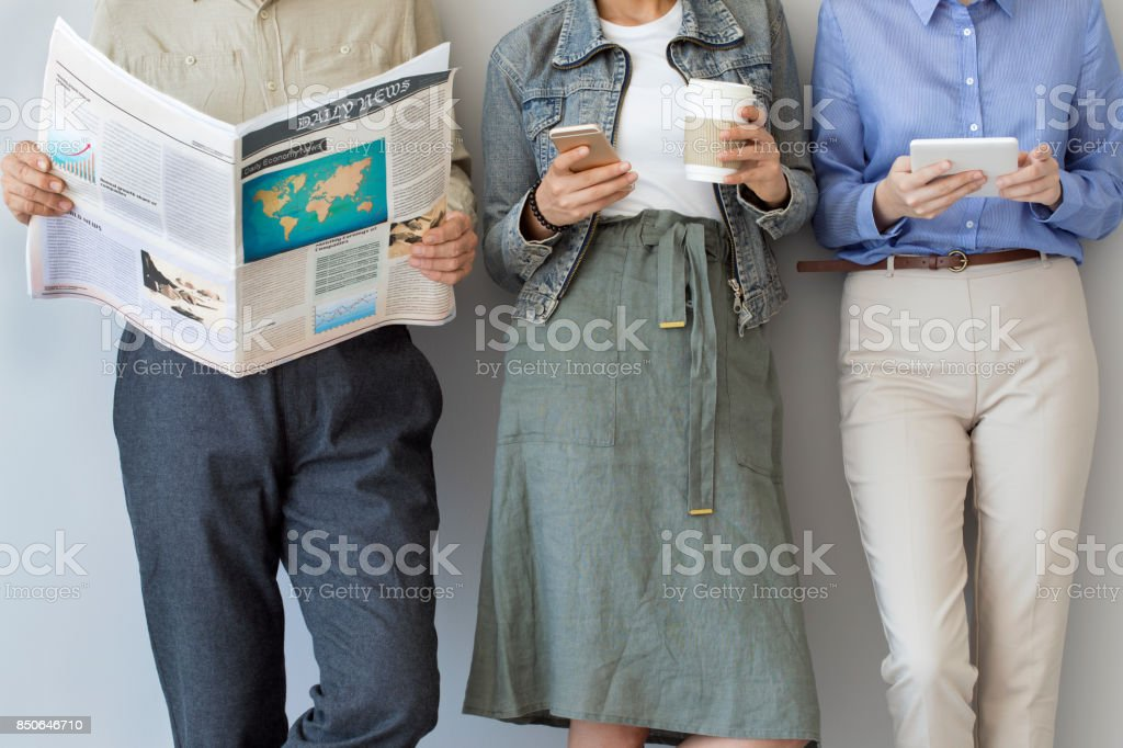 Coworkers standing near a wall stock photo