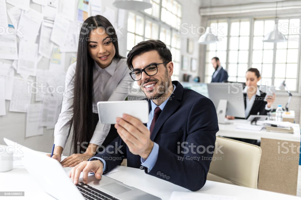 Coworkers Taking Selfie At Work Stock Photo More Pictures Of 20 29
