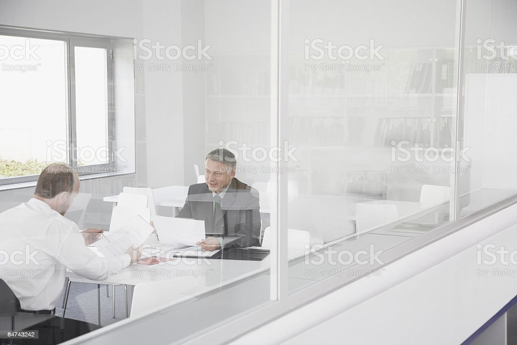 Co-workers talking in conference room royalty-free stock photo