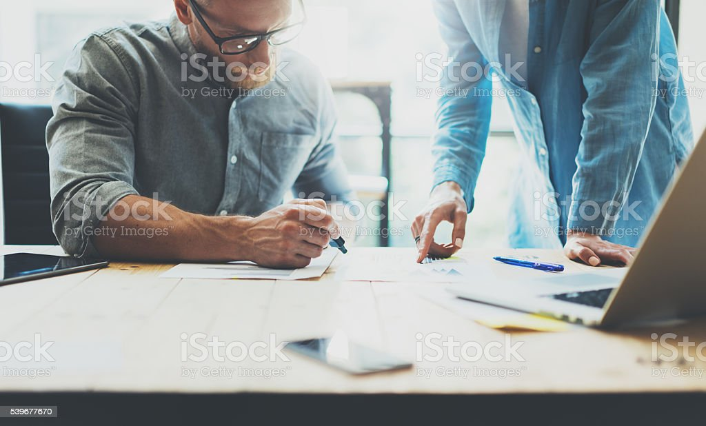 Coworkers team brainstorming process in modern office.Project manager wearing stock photo
