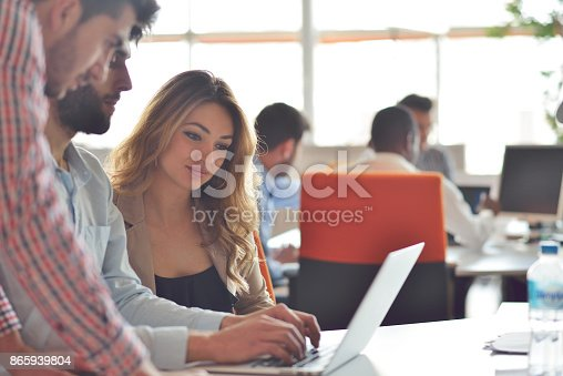 613550610istockphoto Coworkers Team Work Modern Office Place. 865939804