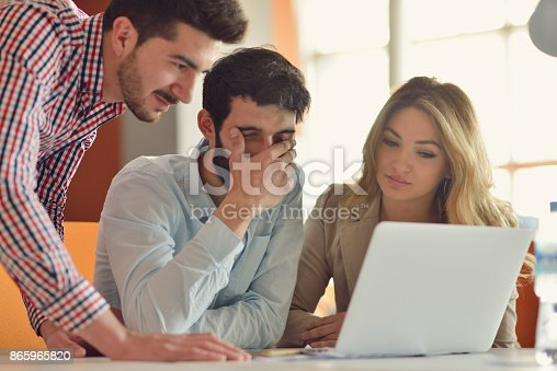 613550610istockphoto Coworkers Team Work Modern Office Place. 865965820