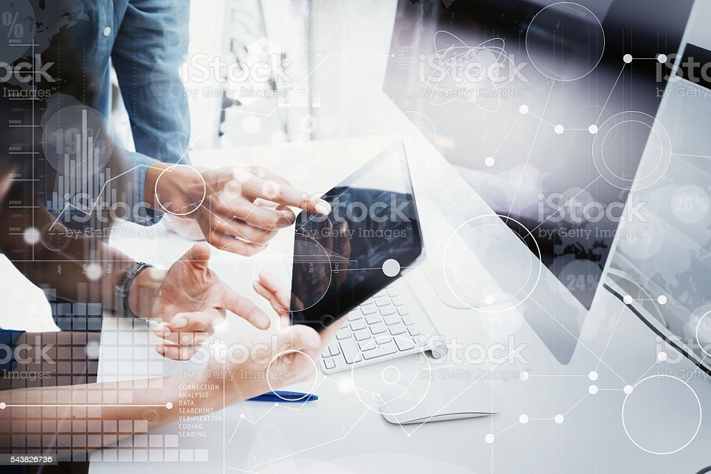 Coworkers Team Working Office Studio Startup.Businessman Using Modern Tablet stock photo
