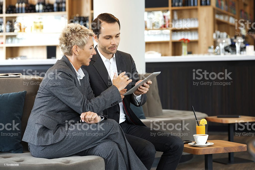 Coworkers Using Digital Tablet royalty-free stock photo