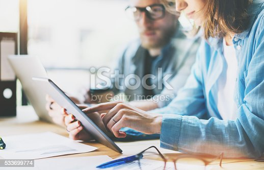 533699494istockphoto Coworkers work modern studio.Production managers team working new project 533699774