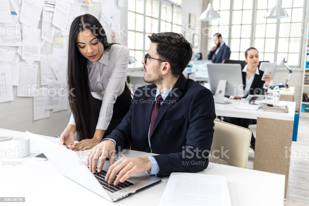 Coworkers working and planning in office stock photo