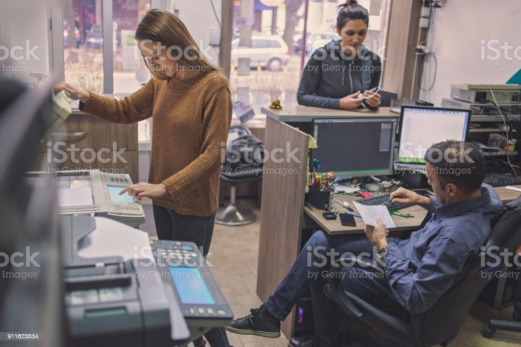 Coworkers working at the office stock photo