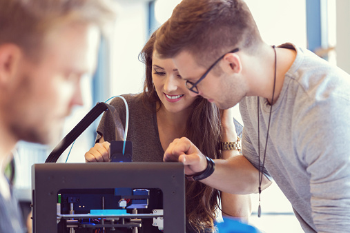 Coworkers Working In An 3d Printer Office Stock Photo - Download Image Now