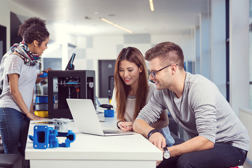 Coworkers Working On Laptop In 3d Printer Office Stock Photo - Download Image Now