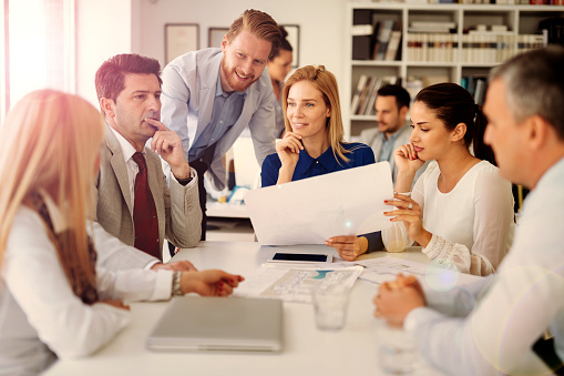 Coworkers Working On Project Together In Office Stock Photo - Download Image Now