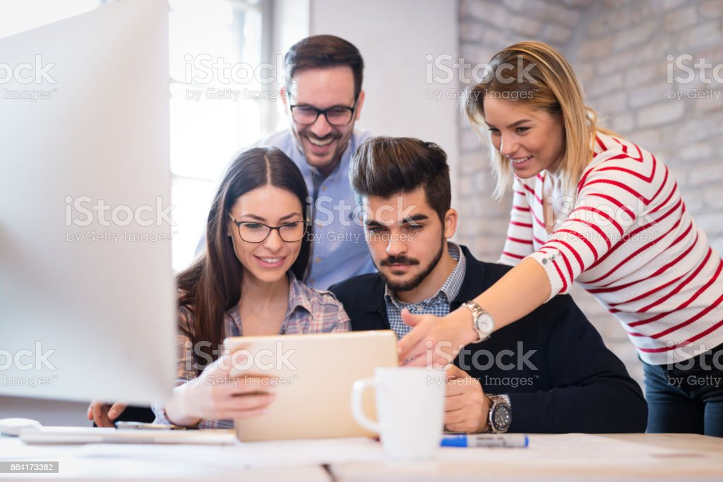Coworkers working on project together in office royalty-free stock photo