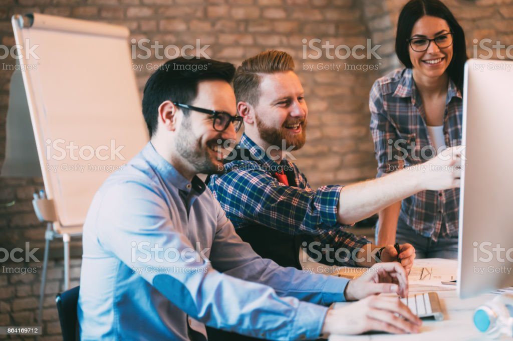 Coworkers working together as a team and discussing ideas royalty-free stock photo