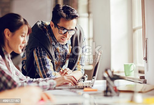 507263268 istock photo Coworkers working together 499122182