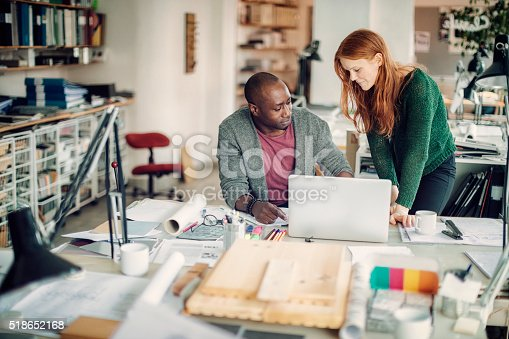507263268 istock photo Coworkers working together 518652168