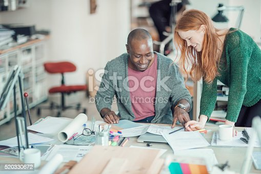 507263268 istock photo Coworkers working together 520330672
