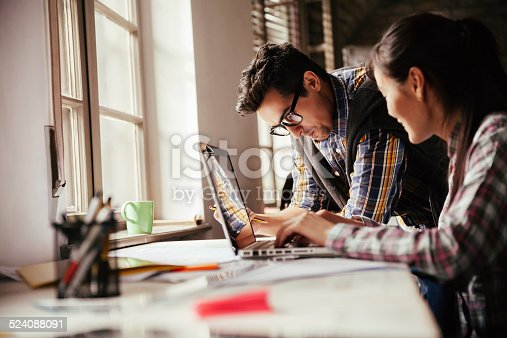 507263268 istock photo Coworkers working together 524088091