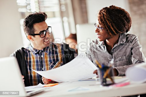 507263268 istock photo Coworkers working together 539279641
