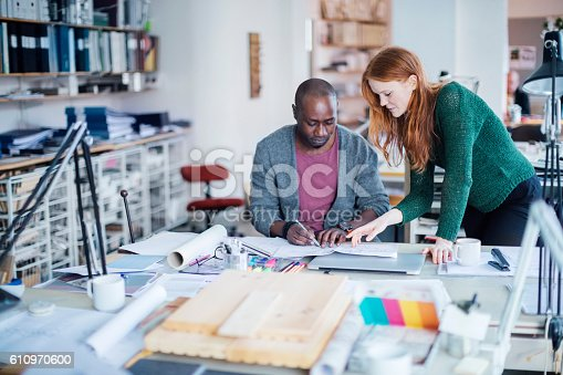 507263268 istock photo Coworkers working together 610970600