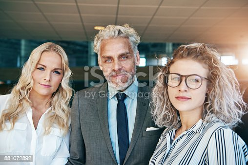 istock Coworking business men and women looking at camera 881072892