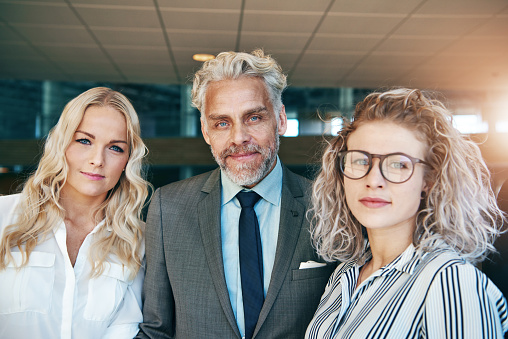 690855708 istock photo Coworking business men and women looking at camera 881072892