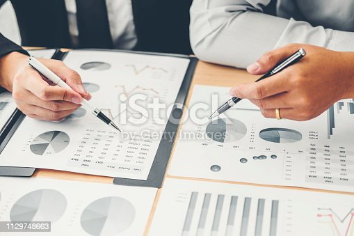 885956164istockphoto Co-working Business Team Consulting meeting Planning Strategy Analysis investment and saving concept. meeting discussing new plan financial graph data. 1129748663