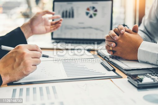 885956164istockphoto Co-working Business Team Consulting meeting Planning Strategy Analysis investment and saving concept. meeting discussing new plan financial graph data. 1129748733