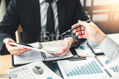 885956164istockphoto Co-working Business Team Consulting meeting Planning Strategy Analysis investment and saving concept. meeting discussing new plan financial graph data. 1129748751