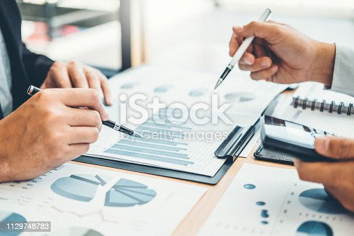 885956164istockphoto Co-working Business Team Consulting meeting Planning Strategy Analysis investment and saving concept. meeting discussing new plan financial graph data. 1129748783