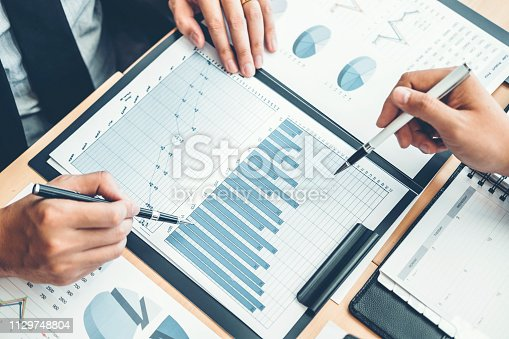885956164istockphoto Co-working Business Team Consulting meeting Planning Strategy Analysis investment and saving concept. meeting discussing new plan financial graph data. 1129748804