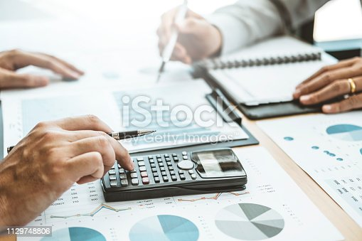 885956164istockphoto Co-working Business Team Consulting meeting Planning Strategy Analysis investment and saving concept. meeting discussing new plan financial graph data. 1129748806