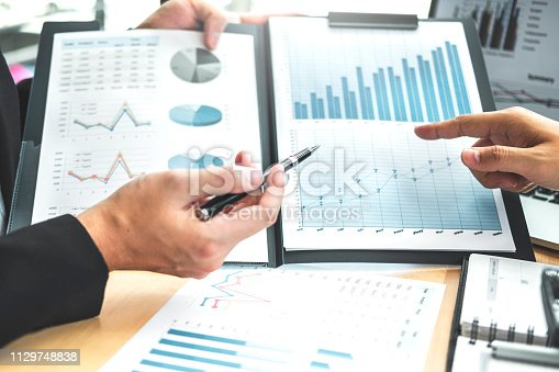 885956164istockphoto Co-working Business Team Consulting meeting Planning Strategy Analysis investment and saving concept. meeting discussing new plan financial graph data. 1129748838