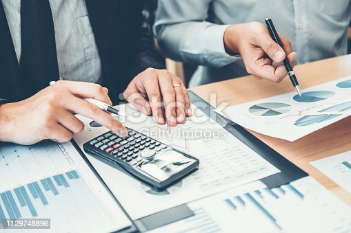 885956164istockphoto Co-working Business Team Consulting meeting Planning Strategy Analysis investment and saving concept. meeting discussing new plan financial graph data. 1129748896