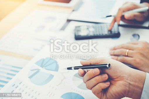885956164istockphoto Co-working Business Team Consulting meeting Planning Strategy Analysis investment and saving concept. meeting discussing new plan financial graph data. 1129748923