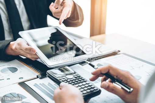 885956164istockphoto Co-working Business Team Consulting meeting Planning with digital tablet Strategy Analysis investment and saving concept. meeting discussing new plan financial graph data. 1129748654