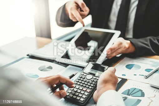 885956164istockphoto Co-working Business Team Consulting meeting Planning with digital tablet Strategy Analysis investment and saving concept. meeting discussing new plan financial graph data. 1129748855