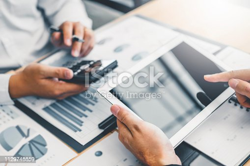 istock Co-working Business Team Consulting meeting Planning with digital tablet Strategy Analysis investment and saving concept. meeting discussing new plan financial graph data. 1129748859