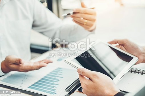 885956164istockphoto Co-working Business Team Consulting meeting Planning with digital tablet Strategy Analysis investment and saving concept. meeting discussing new plan financial graph data. 1129748875