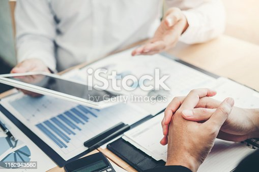 885956164istockphoto Co-working Business Team Consulting meeting Planning with digital tablet Strategy Analysis investment and saving concept. meeting discussing new plan financial graph data. 1152943560
